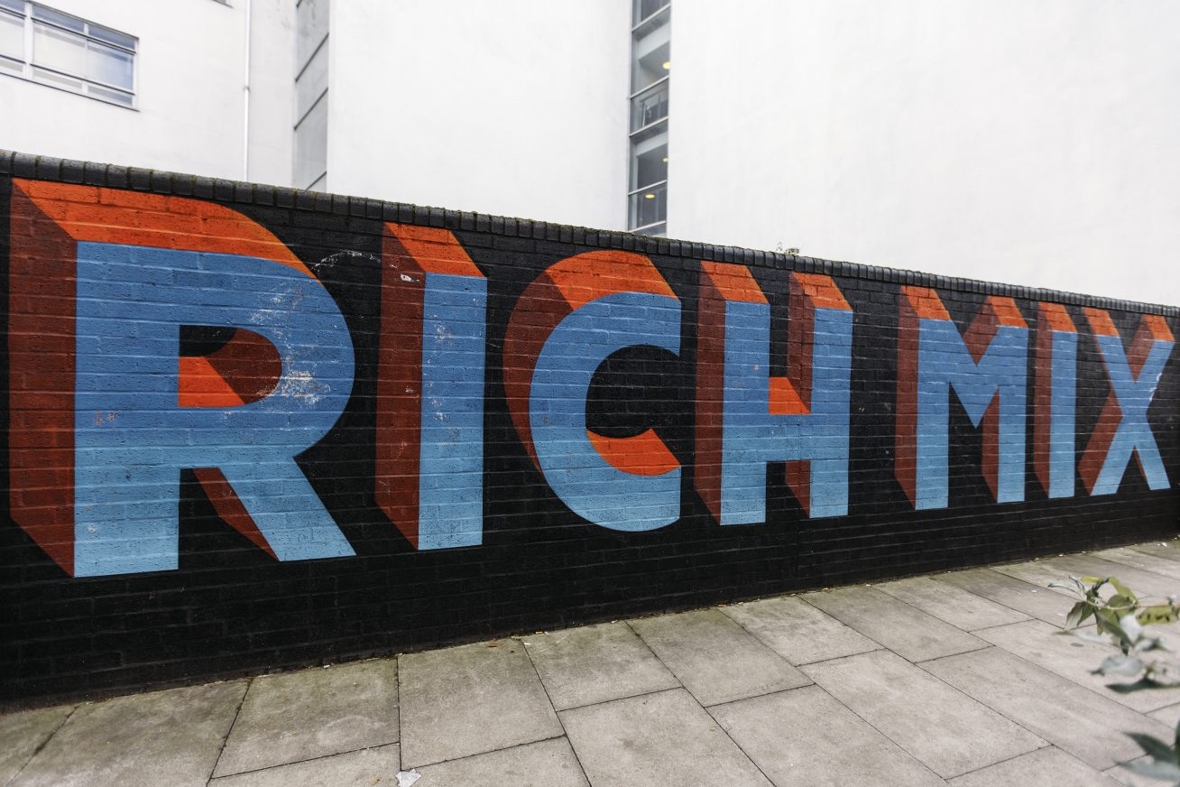 A wall with graffiti saying Rich Mix
