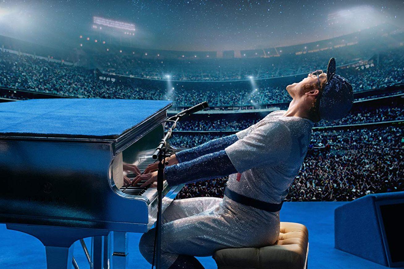 Rocketman - Actor Taron Egerton as Elton John plays a piano on stage