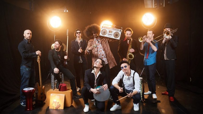 A band pose with their instruments