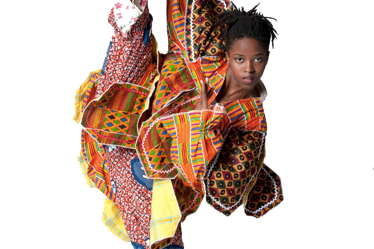 Celebrating Afro-Luso culture - a dancer poses in a split pose