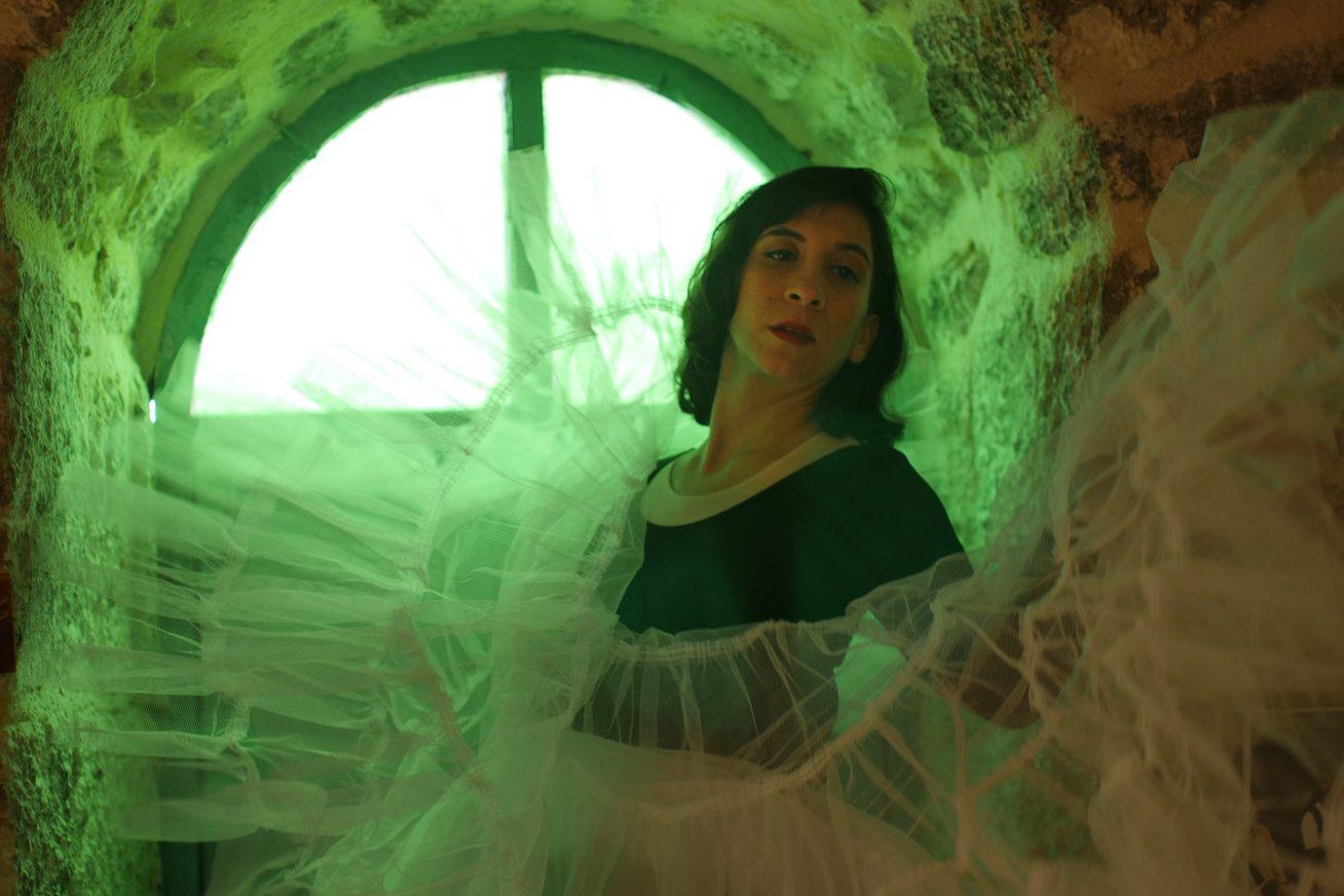 woman in green lighting