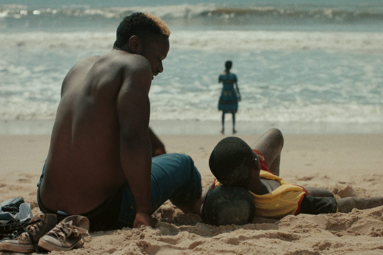 A man and his son sat on the beach